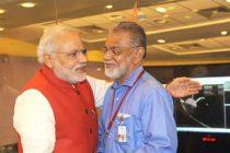 The Prime Minister, Narendra Modi congratulating the ISRO Chairman, Dr. K Radhakrishnan after successful Insertion of Mars Orbiter