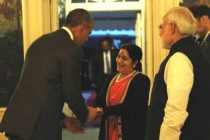 US President Barack Obama meets External Affairs Minister Sushma Swaraj as PM looks on, at the White House dinner
