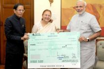 The Speaker, Lok Sabha, Sumitra Mahajan calls on the Prime Minister, Narendra Modi and handing over a cheque for Rs. 14 lakh