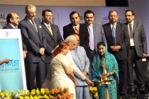 "The Prime Minister, Narendra Modi lighting the lamp at the ""Invest Madhya Pradesh – Global Investors Summit 2014"""