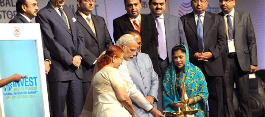 "The Prime Minister, Narendra Modi lighting the lamp at the ""Invest Madhya Pradesh – Global Investors Summit 2014"""