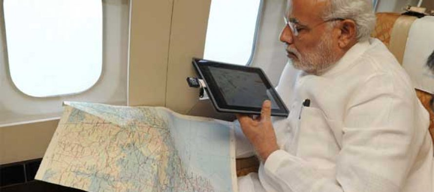 The Prime Minister, Narendra Modi taking an aerial survey of cyclone affected areas of Andhra Pradesh and Odisha, on October 14, 2014.