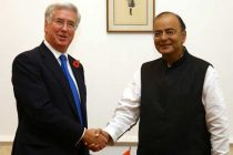 The Secretary of State for Defence, United Kingdom, Michael Fallon calling on the Minister for Finance, Corporate Affairs and Defence, Arun