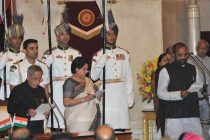 The President, Pranab Mukherjee administering the oath as Minister of State to Hansraj Gangaram Ahir, at a Swearing-in Ceremony