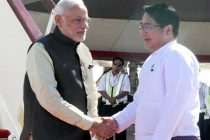 The Prime Minister, Narendra Modi being received by the Minister of Health, Myanmar, Than Aung, on his arrival in Nay Pyi Taw