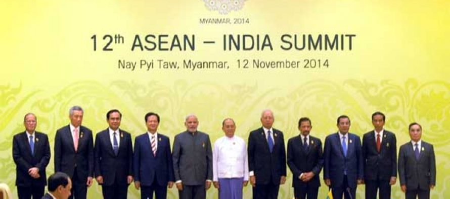 The Prime Minister, Narendra Modi in a group photo with the Heads of State/Government of 12th ASEAN-India Summit