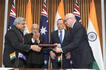The Prime Minister, Narendra Modi and the Prime Minister of Australia, Tony Abbott witnessing the signing of agreements