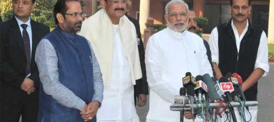 The Prime Minister, Shri Narendra Modi interacting with the media on his arrival at Parliament House for the Winter Session