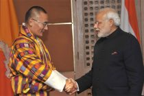The Prime Minister, Narendra Modi being greeted by the Prime Minister of Bhutan, Tshering Tobgay, at the 18th SAARC Summit