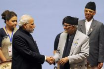 The Prime Minister, Narendra Modi with the Prime Minister of Nepal, Sushil Koirala at the inaugural session of the 18th SAARC Summit