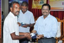 B. Surender Mohan CMD,NLC  handing over the Driving  Licence to the  beneficiary  from a Peripheral village on the concluding day of Communal Harmony Campaign Week 2014