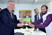 The MoS for Environment, Forest and Climate Change (IC), Prakash Javadekar presenting the book on Climate Change authored by the Prime Minister, Narendra Modi, to the Vice Chairman, NDRC, China,