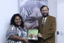 The MoS for Environment, Forest and Climate Change (IC), Prakash Javadekar presenting the book on Climate Change