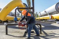 Russia to slash oil output next year