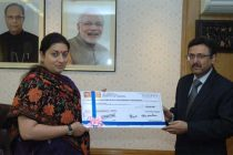 The Minister for Human Resource Development, Smriti Irani receiving the cheque from the Ed-CIL, in New Delhi on January 19, 2015.