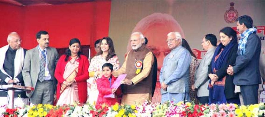 The PM, Narendra Modi launching the Sukanya Samridhi Account Scheme at the launch of the 'Beti Bachao, Beti Padhao' Programme