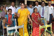 B. Surender Mohan, CMD, NLC and Smt. Surender mohan Presenting  Tricycles to Mahalakshmi and Iyammal
