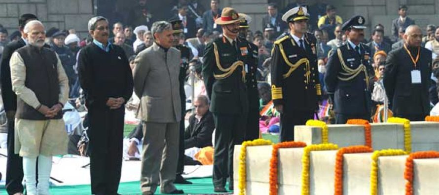 The Prime Minister, Narendra Modi paying homage at the Samadhi of Mahatma Gandhi on the occasion of Martyr's Day, at Rajghat,