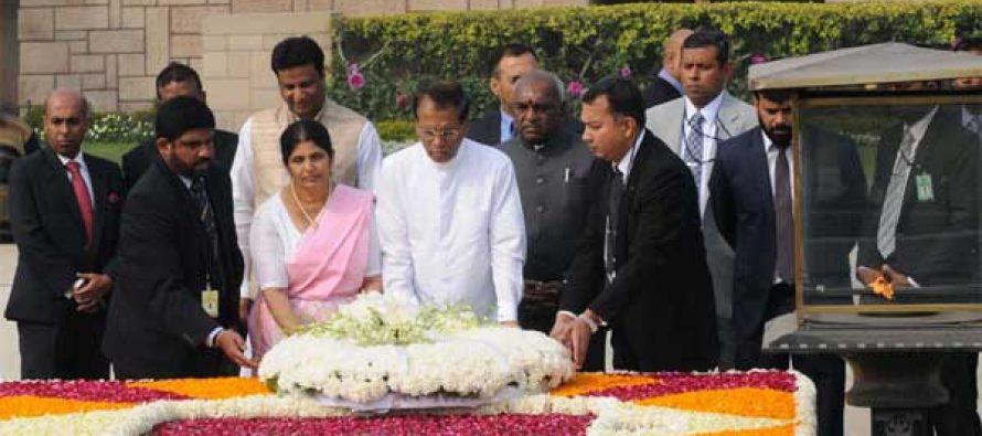 The President of the Democratic Socialist Republic of Sri Lanka, Maithripala Sirisena and Jayanthi Sirisena laying wreath at the Samadhi of Mahatma Gandhi,