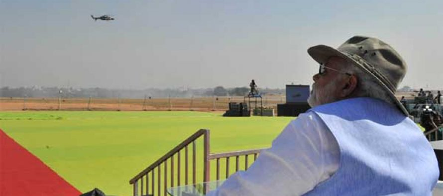 The Prime Minister, Narendra Modi watching the Aero India-2015 Air Show, in Bangalore on February 18, 2015.
