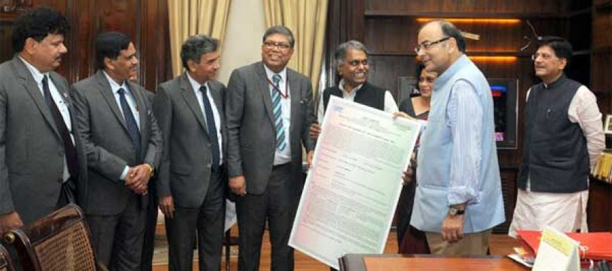 The CMD, NTPC, Arup Roy Choudhury presenting the Bonus Debenture Certificate by NTPC to Union Minister for Finance,