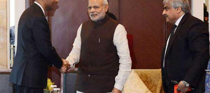 The Deputy Prime Minister, Singapore, Tharman Shanmugaratnam calls on the Prime Minister, Narendra Modi, in Singapore.