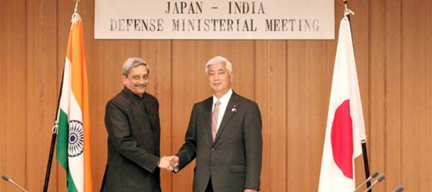The Minister for Defence, Manohar Parrikar shaking hands with his Japanese counterpart General Nakatani