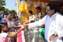 B . Surender Mohan  CMD, NLC and Swarna Kumari Surender Mohan  distributing  prasadam to devotees ,on the eve of PANGUNI UTHIRAM  festival  at Neyveli Township ,on 03 April 2015.