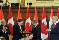 The Prime Minister, Narendra Modi and the Prime Minister of Canada, Stephen Harper witnessing the exchange of signed documents,