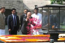 The President of the Islamic Republic of Afghanistan, Dr. Mohammad Ashraf Ghani paying floral tributes at the Samadhi of Mahatma Gandhi,