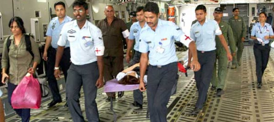 The Indian Air Force (IAF) Rapid Action Medical Team helping a stranded person evacuated by an IAF aircraft from earthquake hit Nepal,