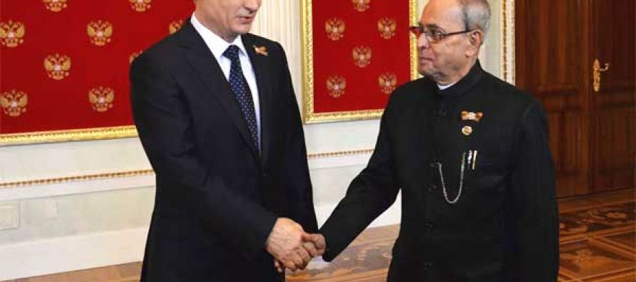 The President of India, Pranab Mukherjee, being received by Vladimir V Putin, the President of the Russian Federation
