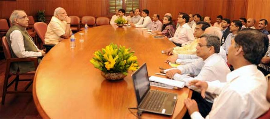 The PM, Narendra Modi interacting with the officers of the Prime Minister's Office, on the occasion of first anniversary of his Government