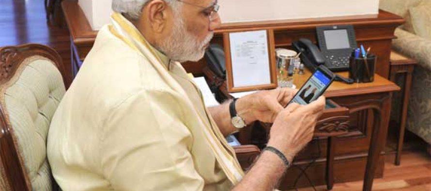 The Prime Minister, Narendra Modi launching the 'Narendra Modi Mobile App', in New Delhi on June 17, 2015.