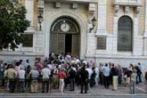 Greece reveals new debt deal, pensioners line up at banks