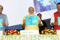 Prime Minister, Narendra Modi releasing the National Skill Development Mission document at the launch of the Skill India
