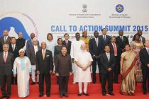 "The Prime Minister, Narendra Modi in a group photograph with the dignitaries at the Global ""Call to Action"" Summit 2015"