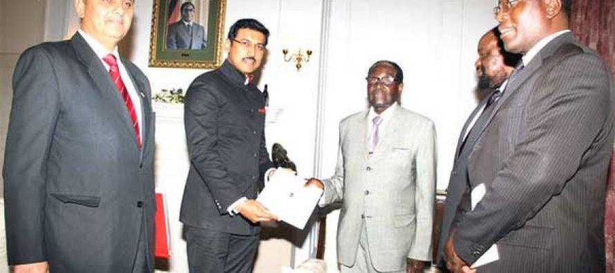 MoS for I&B, Col. Rajyavardhan Singh Rathore meeting the President of the Republic of Zimbabwe Robert Gabriel Mugabe