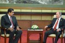 Maduro, Putin agree to take steps to raise oil prices