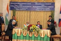 Vice President, Mohd. Hamid Ansari and the Vice President of Lao PDR, Bounnhang Vorachith witnessing the signing of an agreement