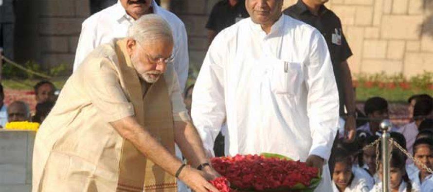 Prime Minister, Narendra Modi paying floral tributes at the Samadhi of Mahatma Gandhi on his 146th birth anniversary