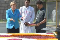The German Chancellor, Dr. Angela Merkel paying floral tributes at the Samadhi of Mahatma Gandhi, at Rajghat, in Delhi