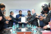 CEO of GTT, France, Philippe Berterottiere handing over the license agreement to the CMD, Cochin Shipyard Ltd., K. Subramaniam