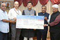 CMD, Power Finance Corporation Ltd. (PFC), M.K. Goel presenting the interim dividend cheque of Rs.402.71 crore for the Financial Year