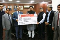CMD of North Eastern Electric Power Corporation Ltd. (NEEPCO), P.C. Pankaj presenting the interim dividend cheque of Rs.22.59 for the FY' of 2015-16