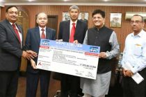 CMD of National Hydroelectric Power Corporation Ltd. (NHPC), K.M. Singh presenting the interim dividend cheque of Rs.875.49 for the FY' of 2015-16