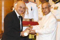 President, Pranab Mukherjee presenting the Padma Bhushan Award to Anupam Pushkarnath Kher,