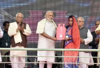 Prime Minister, Narendra Modi distributing the free LPG connections to the beneficiaries, under 'Pradhan Mantri Ujjwala Yojana