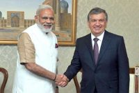Prime Minister, Narendra Modi in a brief meeting with the Prime Minister of Uzbekistan, Shavkat Mirziyoev, in Uzbekistan
