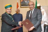 MoS for Finance and Corporate Affairs, Arjun Ram Meghwal exchanging the Memorandum of Understanding on Standards